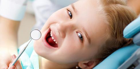 Little girl smiling whilst visiting the childrens dentist